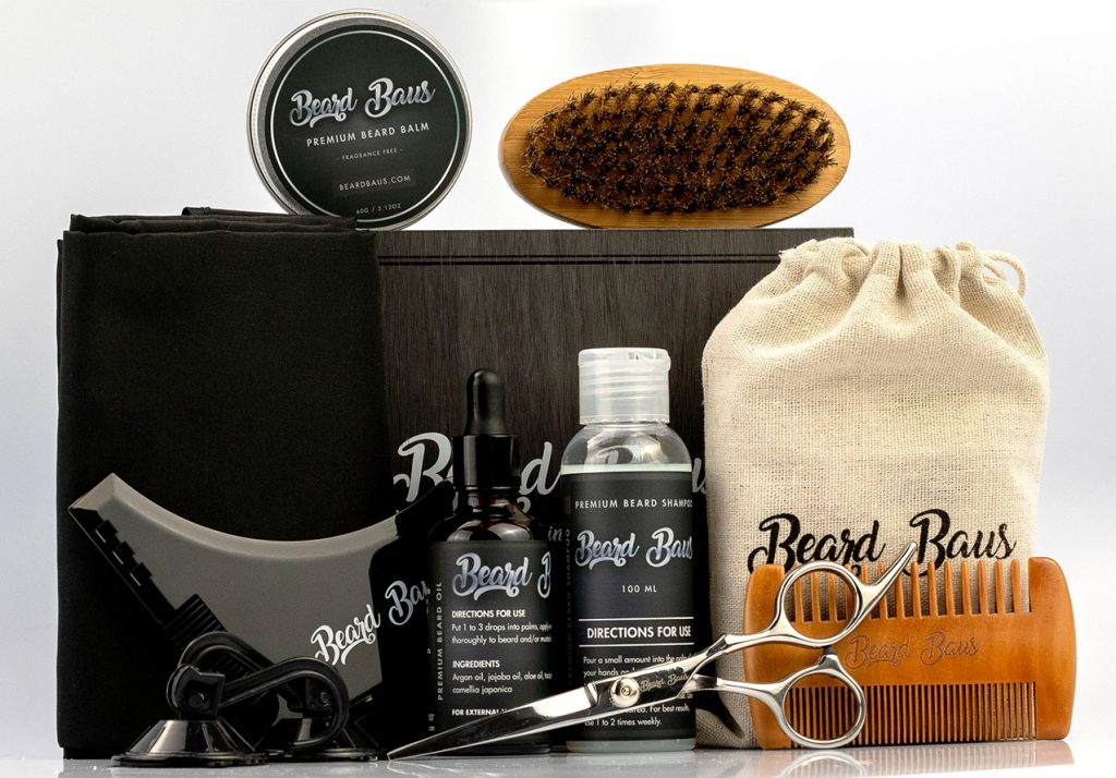 Entire Beard Baus Grooming Kit for Men. Beard Baus Beard Grooming Kit for men. Grooming kit includes unsented beard oil, unsented beard balm, 100% boar bristle brush, beard comb, stainless steel scissors, beard shampoo, shaping tool, and beard apron.