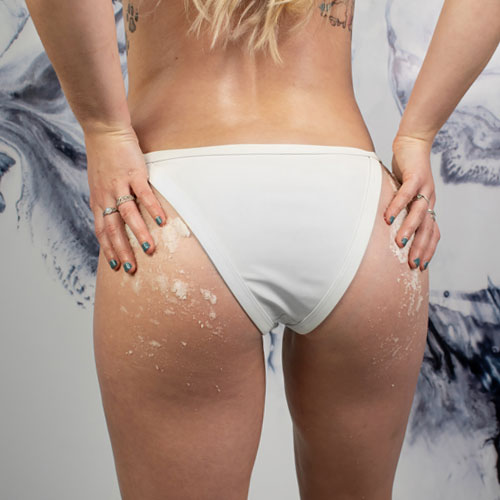 Model with body scrub on her butt.