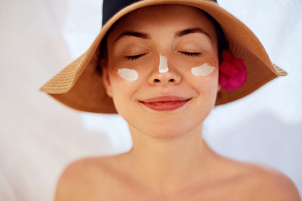 sunscreen on womans face