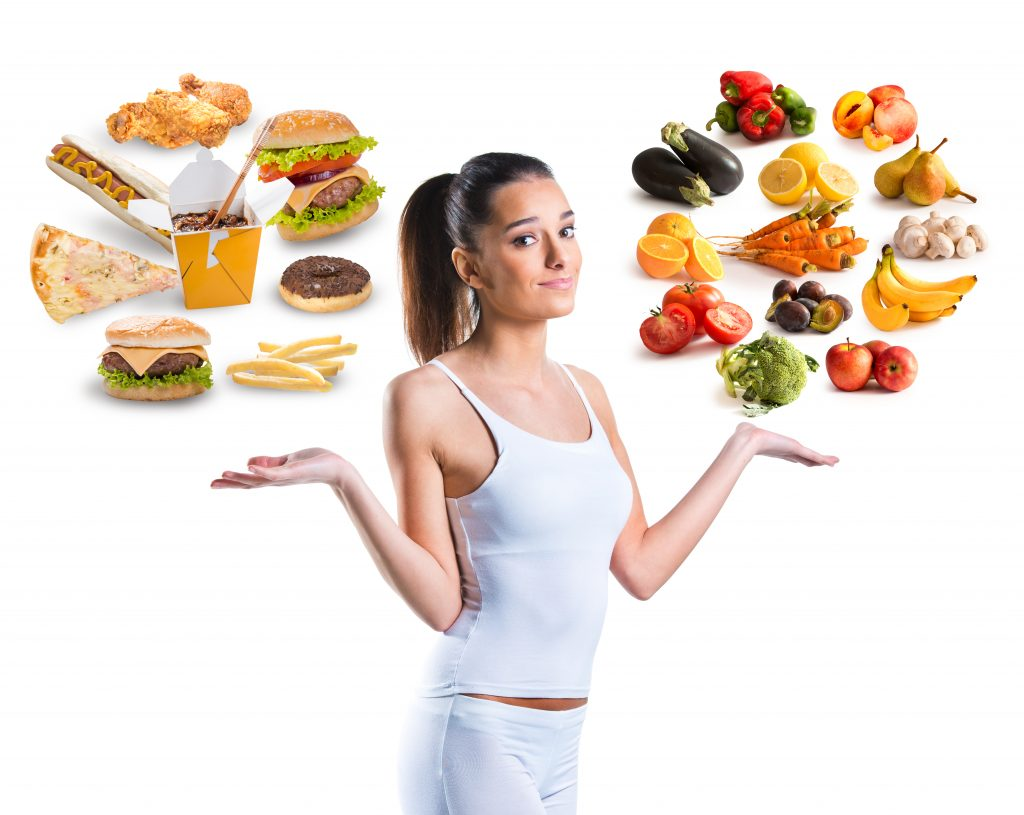 junk food and healthy food poor diet good diet with woman