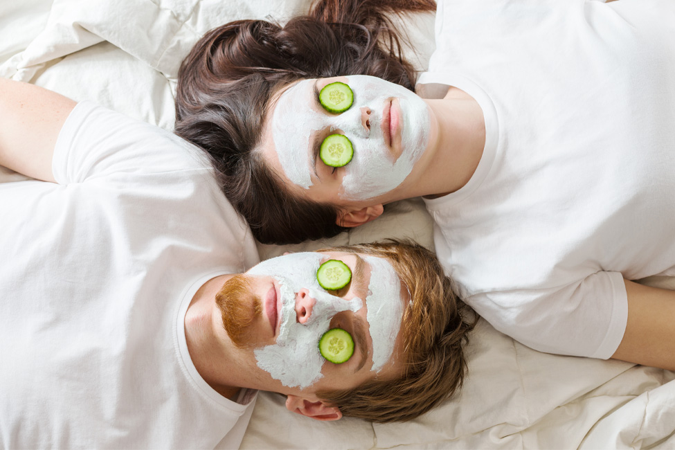man-and-woman-wearing-mask-and-cucumbers