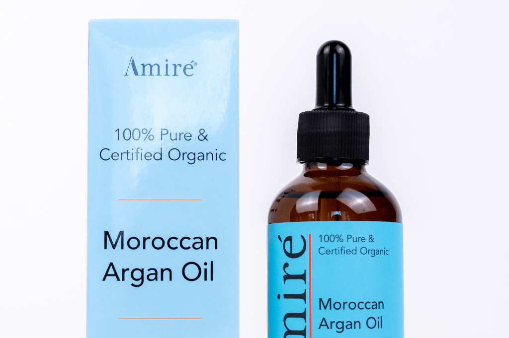 100 percent pure and organic moroccan argan oil for hair, skin, and nails with blue packaging-cut off